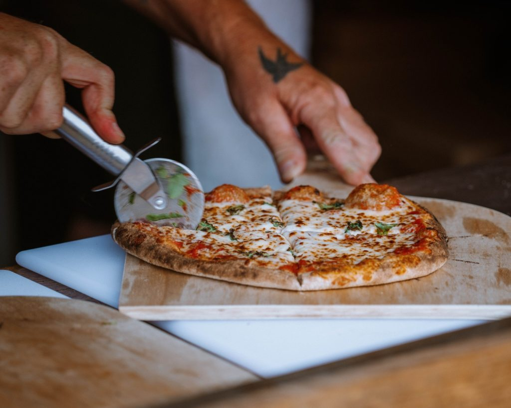 a slice of pizza on a cutting board